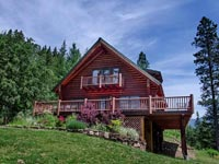 This is a timeless log cabin on the edge of the beautiful Kaniksu National Forest in North Idaho. Enjoy the tranquil sounds of the rapidly running Trestle Creek.