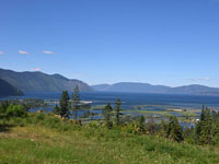 Panoramic view of Lake Pend Oreille and the beautiful Green Monarch Mountains a premier lot on Majestic Mountain Road.